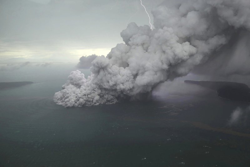 This aerial shot taken on Sunday, Dec. 23, 2018, shows volcanic material spew from the crater of Mount Anak Krakatau as it erupts on Java Strait, Indonesia. (Nurul Hidayat/Bisnis Indonesia via AP)