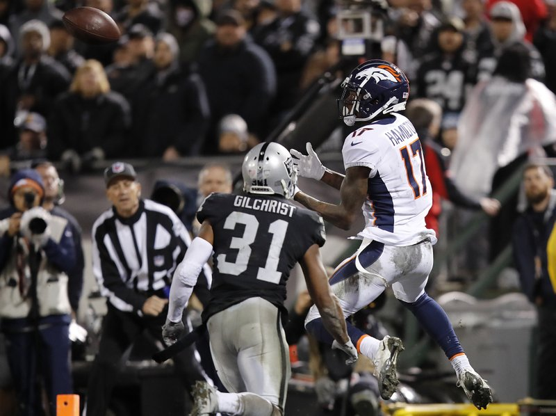Denver Broncos wide receiver DaeSean Hamilton (17) catches a touchdown pass against Oakland Raiders defensive back Marcus Gilchrist (31) during the second half of an NFL football game in Oakland, Calif. (AP Photo/John Hefti)