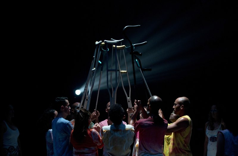 In this Dec. 4, 2018 photo, dancers hold canes and crutches in unison as they perform in the contemporary dance production Ubuntu, at the Teresa Carreno Theater in Caracas, Venezuela. (AP Photo/Fernando Llano)