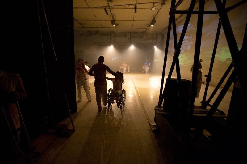In this Dec. 4, 2018 photo, dancers take the stage to perform in the contemporary dance production Ubuntu, at the Teresa Carreno Theater in Caracas, Venezuela. (AP Photo/Fernando Llano)
