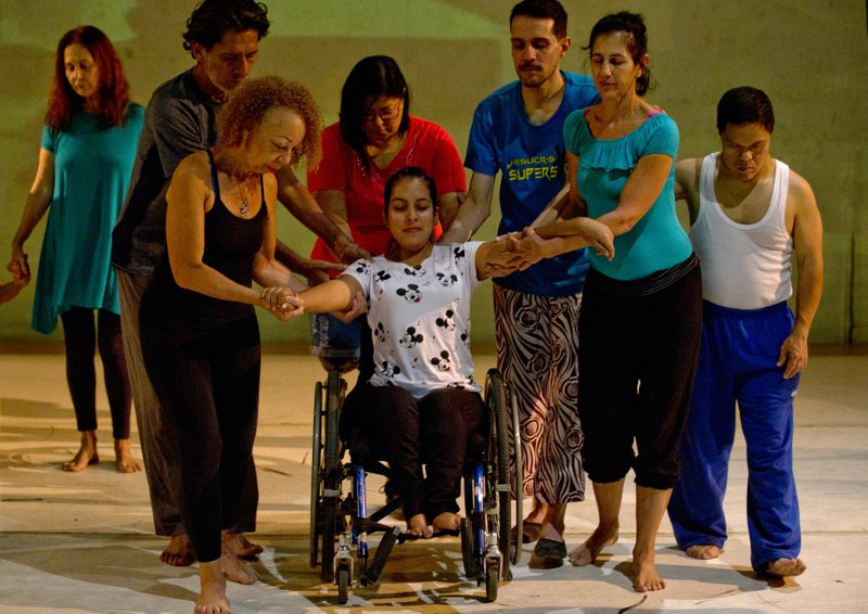In this Dec. 4, 2018 photo, dancers practice prior to their last performance in the contemporary dance production Ubuntu, at the Teresa Carreno Theater in Caracas, Venezuela. (AP Photo/Fernando Llano)
