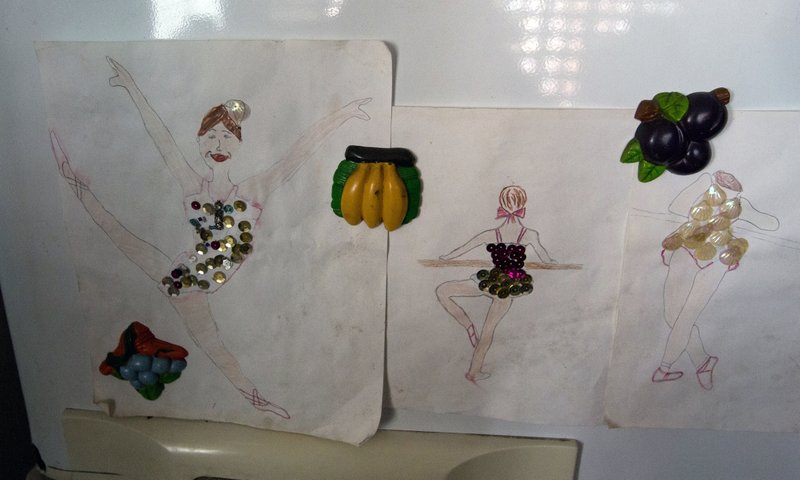 In this Dec. 17, 2018 photo, drawings of dancers made by Iraly Yanez's niece decorates her fridge, in Caracas, Venezuela. (AP Photo/Fernando Llano)
