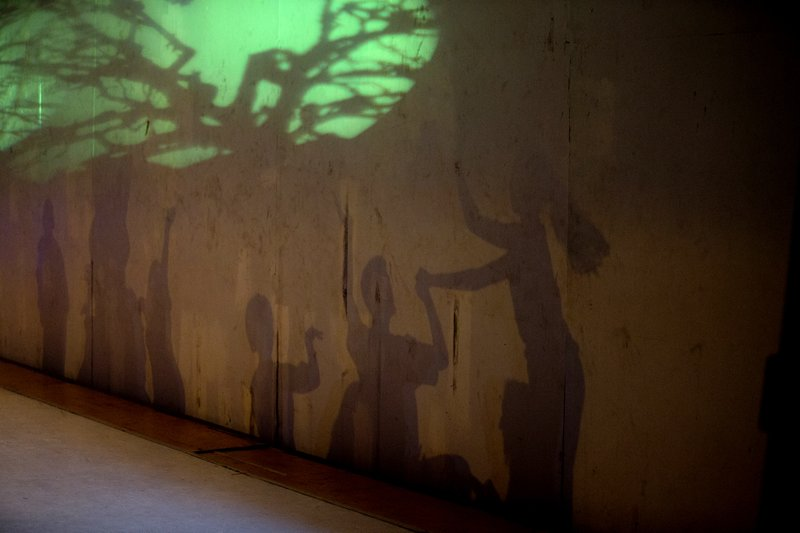 In this Dec. 4, 2018 photo, dancers' shadows are cast on a stage backdrop during the contemporary dance production Ubuntu, at the Teresa Carreno Theater in Caracas, Venezuela. (AP Photo/Fernando Llano)