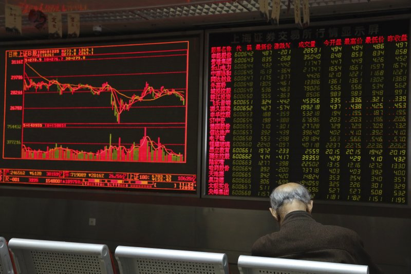 A Chinese man naps at a brokerage in Beijing, China, Tuesday, Dec. 25, 2018. Japanese stocks plunged Tuesday and other Asian markets declined following heavy Wall Street losses triggered by President Donald Trump's attack on the U. (AP Photo/Ng Han Guan)