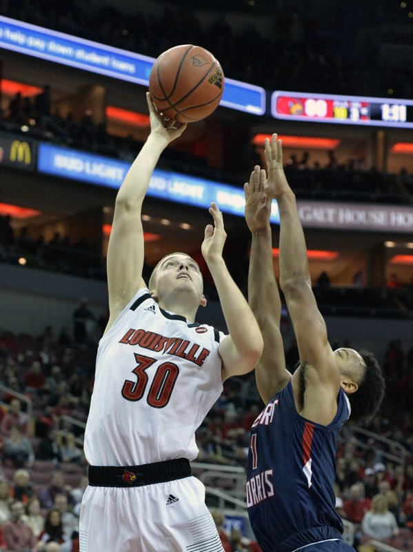 Louisville guard Ryan McMahon (30) shoots over the defense of Robert Morris guard Jon Williams (1) during the second half of an NCAA college basketball game in Louisville, Ky. (AP Photo/Timothy D. Easley)