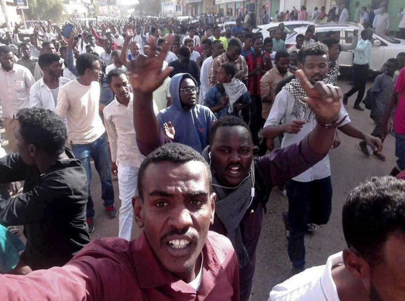 In this Thursday, Dec. 20, 2018 handout photo provided by a Sudanese activist, protesters chant slogans during a demonstration, in Khartoum, Sudan. (Sudanese Activist via AP)