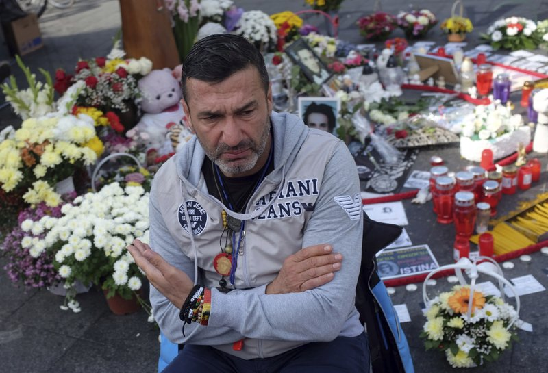 FILE - In this Oct. 6, 2018, file photo, Davor Dragicevic, father of 21-year-old David Dragicevic speaks during an interview with the Associated Press, in the Bosnian town of Banja Luka, northwest of Sarajevo. (AP Photo/Darko Vojinovic, File)