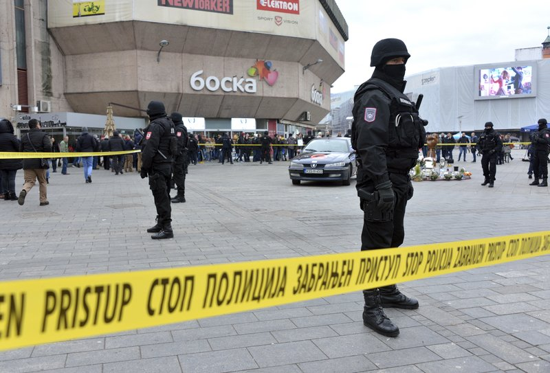 Bosnian Serb police secure an area at the spot where Davor Dragicevic along with members of the