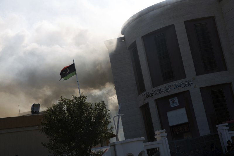 Smoke rises shortly after an attack on the foreign ministry building, in Tripoli, Libya, Tuesday, Dec, 25, 2018. (AP Photo/Mohamed Ben Khalifa)