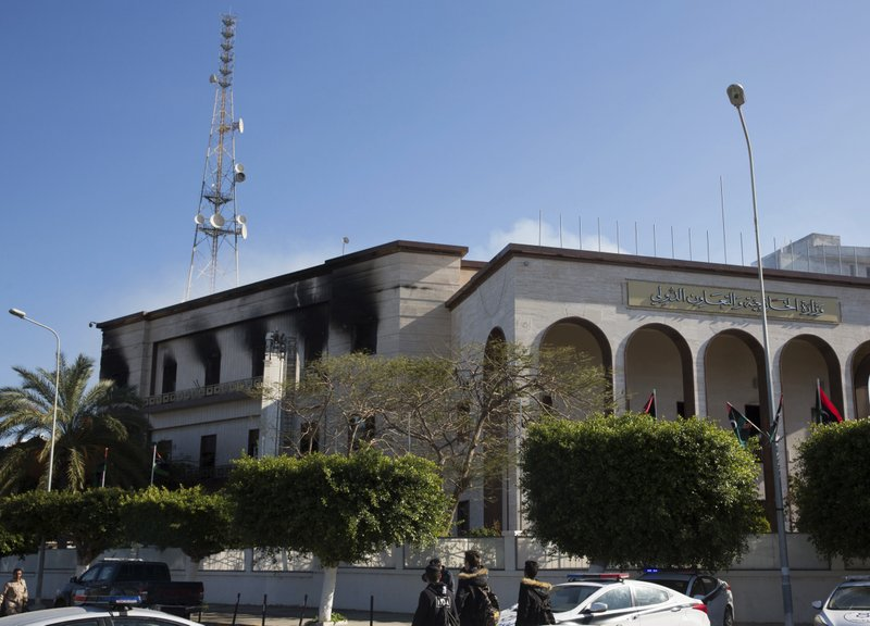 Fire damaged the foreign ministry building, after a deadly attack, in Tripoli, Libya, Tuesday, Dec, 25, 2018. (AP Photo/Mohamed Ben Khalifa)