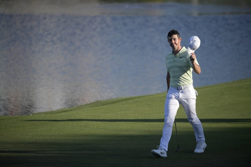 FILE - In this March 18, 2018, file photo, Rory McIlroy, of Northern Ireland, waves his hat to the crowd while walking to his ball on the 18th green during the final round of the Arnold Palmer Invitational golf tournament in Orlando, Fla. (AP Photo/Phelan M. Ebenhack, File)