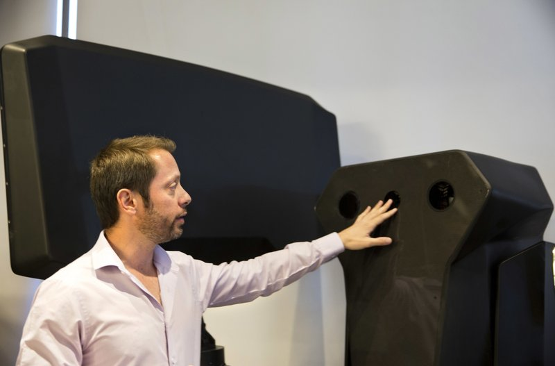 Product manager Asaf Lebovitz from the Israeli anti-drone company Skylock, explains their system's main unit at the company's offices in Petah Tikvah, Israel, Tuesday, Dec. (AP Photo/Sebastian Scheiner)