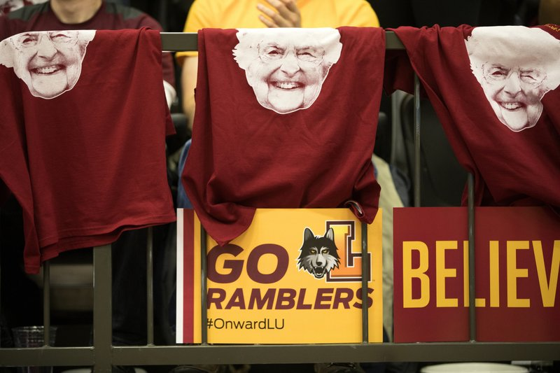 FILE - In this March 31, 2018, file photo, T-shirts with the face of Sister Jean Dolores Schmidt hang from a railing during the March Madness watch party for the Loyola-Chicago vs. (Erin Hooley/Chicago Tribune via AP, File)