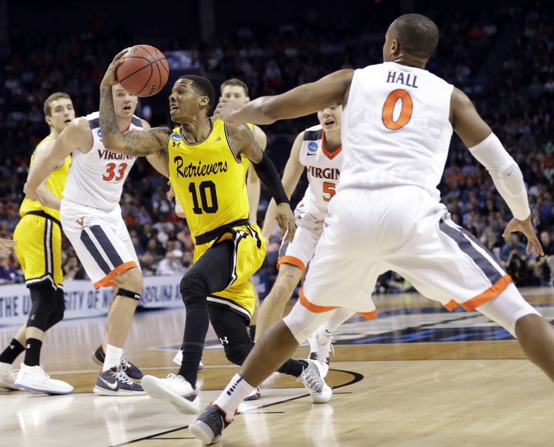 FILE - In this March 16, 2018, file photo, UMBC's Jairus Lyles (10) drives past Virginia's Devon Hall (0) during the second half of a first-round game in the NCAA men's college basketball tournament in Charlotte, N. (AP Photo/Gerry Broome, File)