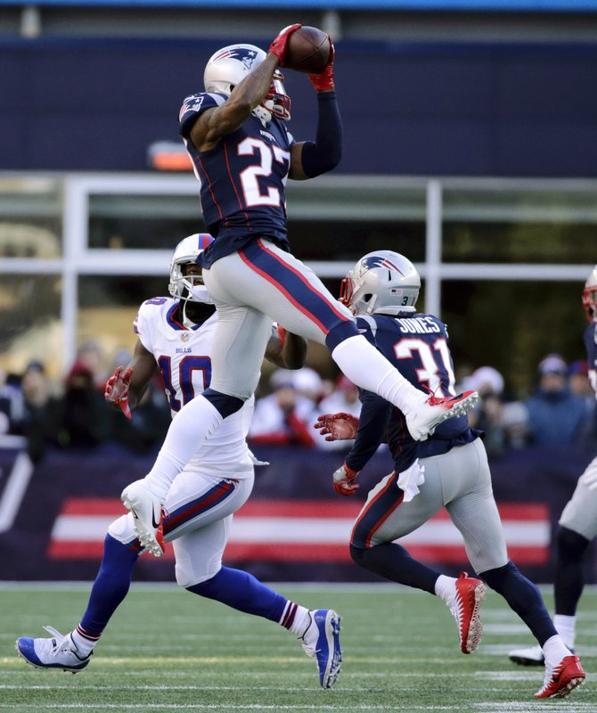 FILE - In this Dec. 23, 2018, file photo, New England Patriots defensive back J.C. Jackson (27) intercepts a pass intended for Buffalo Bills wide receiver Deonte Thompson (10) during the first half of an NFL football game in Foxborough, Mass. (AP Photo/Elise Amendola, File)