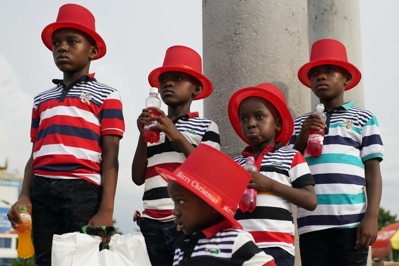 Children pose for a photograph in Kinshasa, Congo, Tuesday Dec. 25, 2018. Traditionally Congolese dress up and take to the parks on Christmas day, this time five days before scheduled presidential and general elections. (AP Photo/Jerome Delay)