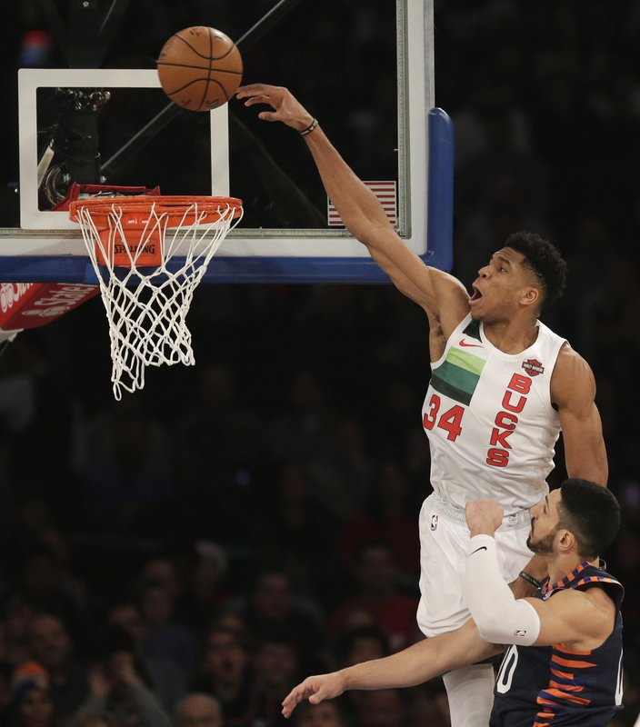 Milwaukee Bucks' Giannis Antetokounmpo, top, tries to dunk over New York Knicks' Enes Kanter during the first half of the NBA basketball game, Tuesday, Dec. (AP Photo/Seth Wenig)
