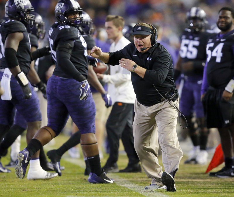 FILE - In this Nov. 24, 2018, file photo, TCU head coach Gary Patterson yells at one of his players during the second quarter of an NCAA college football game against Oklahoma State in Fort Worth, Texas. (Tom Fox/The Dallas Morning News via AP, File)