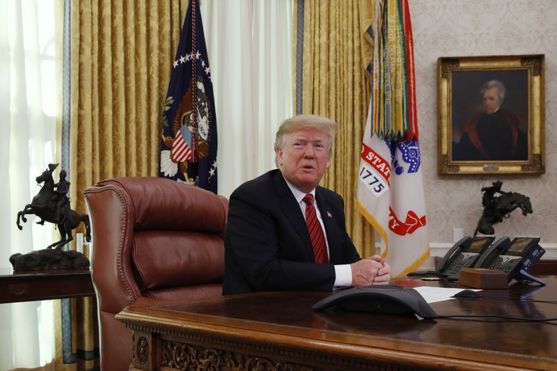 President Donald Trump answers questions from the media after speaking with members of the military by video conference on Christmas Day, Tuesday, Dec. (AP Photo/Jacquelyn Martin)