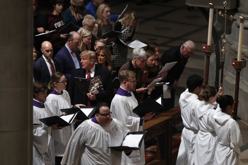 President Donald Trump and first lady Melania Trump attend a Christmas Eve service at the National Cathedral, Monday, Dec. (AP Photo/Jacquelyn Martin)