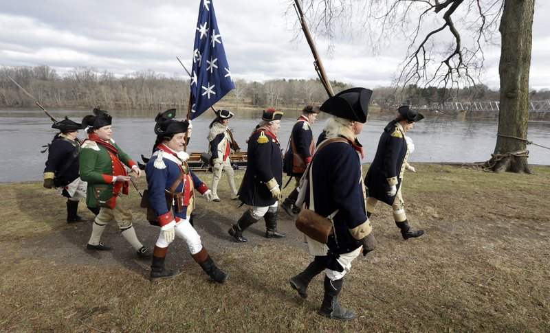 Re-enactor John Godzieba, right, portrays Gen. George Washington as he leads others along the banks of the Delaware River, Tuesday Dec. (AP Photo/Jacqueline Larma)