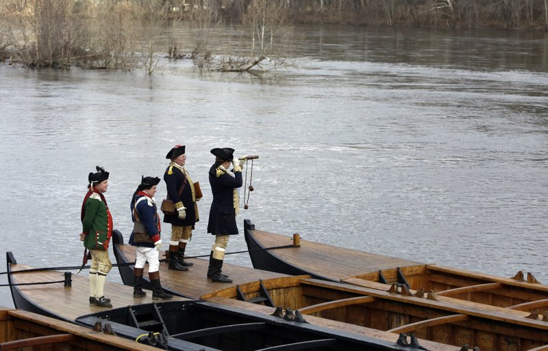 Re-enactor John Godzieba, right, portrays Gen. George Washington as he peers across the Delaware River, Tuesday Dec. (AP Photo/Jacqueline Larma)