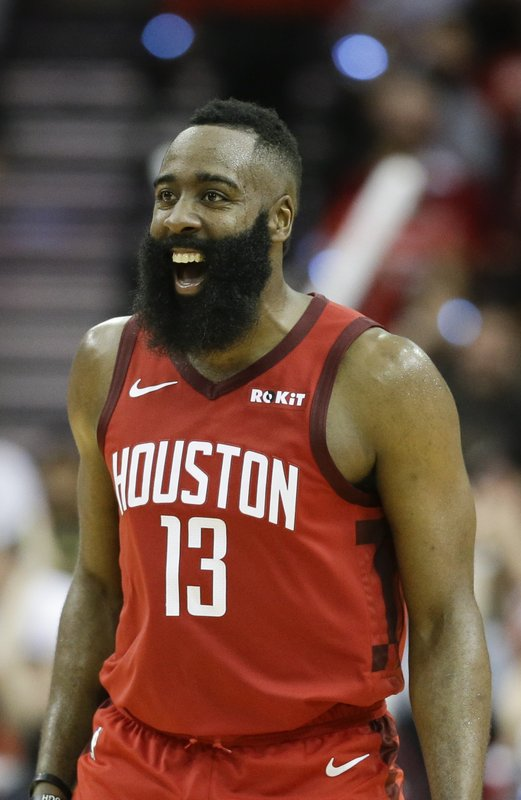 Houston Rockets guard James Harden reacts after guard Austin Rivers' three-point basket late in the second half of an NBA basketball game against the Oklahoma City Thunder, Tuesday, Dec. (AP Photo/Eric Christian Smith)