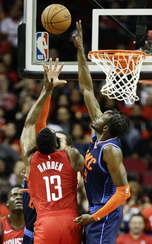 Oklahoma City Thunder forward Jerami Grant, right, blocks the shot of Houston Rockets guard James Harden (13) during the first half of an NBA basketball game, Tuesday, Dec. (AP Photo/Eric Christian Smith)