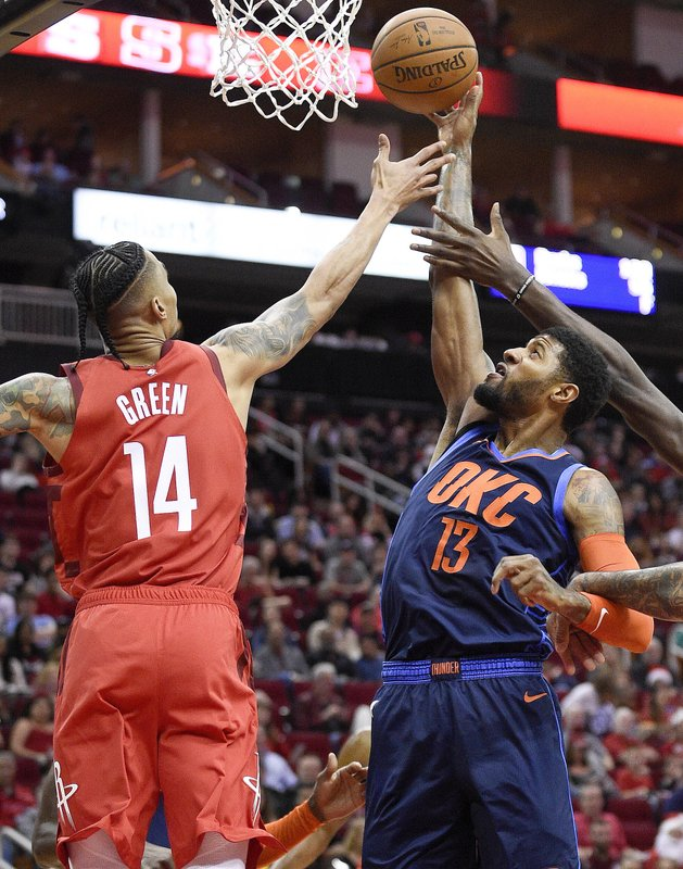 Oklahoma City Thunder forward Paul George, right, grabs a rebound away from from Houston Rockets guard Gerald Green, left, during the first half of an NBA basketball game, Tuesday, Dec. (AP Photo/Eric Christian Smith)
