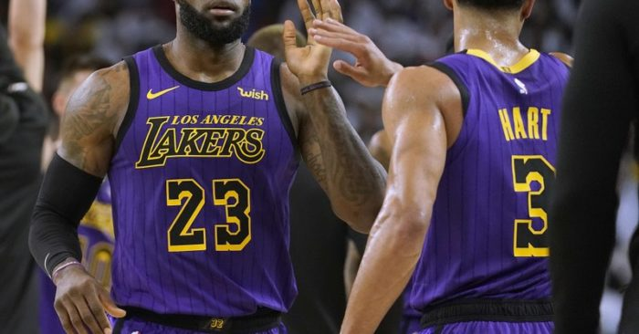 cdc9c5411c3 Los Angeles Lakers forward LeBron James (23) high-fives Josh Hart (3) at  the end of the first half of the team s NBA basketball game against the  Golden ...