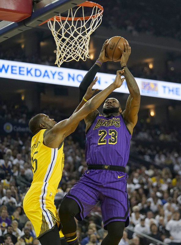 Los Angeles Lakers forward LeBron James (23) shoots over Golden State Warriors forward Kevin Durant (35) during the first half of an NBA basketball game Tuesday, Dec. (AP Photo/Tony Avelar)