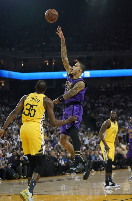 Los Angeles Lakers forward Kyle Kuzma (0) shoots over Golden State Warriors forward Kevin Durant (35) during the first half of an NBA basketball game Tuesday, Dec. (AP Photo/Tony Avelar)