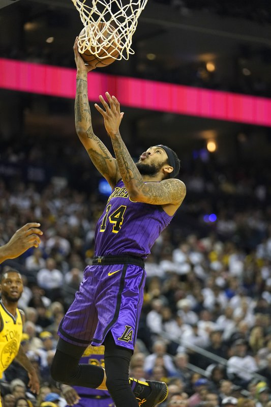 Los Angeles Lakers forward Brandon Ingram (14) drives to the basket against the Golden State Warriors during the first half of an NBA basketball game Tuesday, Dec. (AP Photo/Tony Avelar)