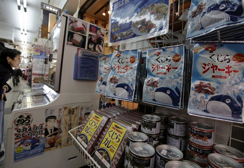 FILE - In this March 27, 2014, file photo, packs of whale meat to be sold hang at a whale meat specialty store at Tokyo's Ameyoko shopping district. (AP Photo/Shizuo Kambayashi, File)