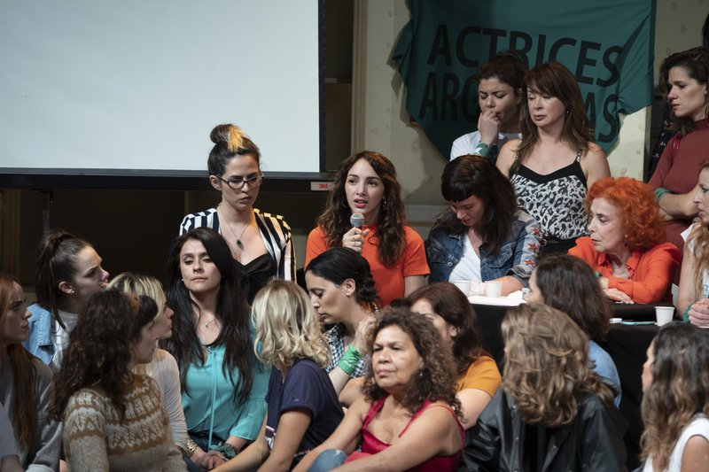 FILE - In this Dec. 11, 2018 file photo, accompanied by members of Argentine Actresses, Thelma Fardin speaks during a press conference where she accuses television star Juan Darthes of raping her when she was 16-years-old, in Buenos Aires, Argentina. (AP Photo/Joaquín Salguero, File)