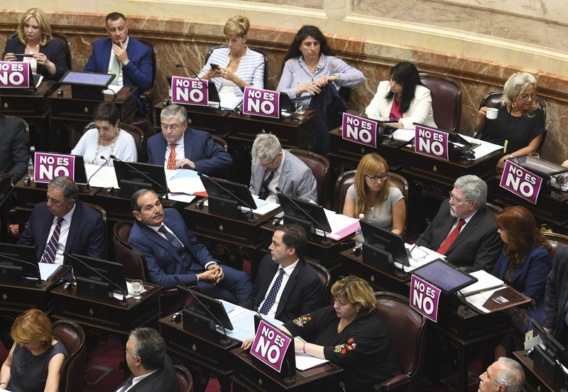 This Dec. 18, 2018 photo shows placards displayed on the desk of female senators with a message that reads in Spanish: