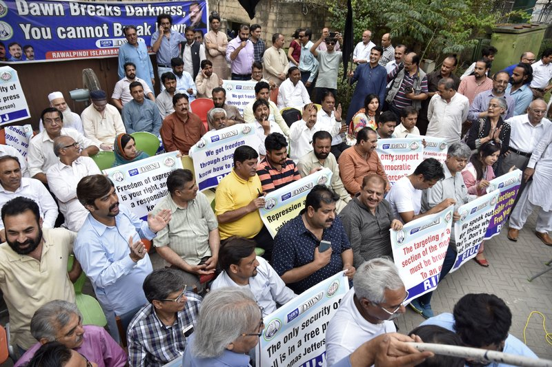 In this July 11, 2018 photo, Pakistani journalists protest against layoffs at newspapers, in Islamabad, Pakistan. (AP Photo/B.K. Bangash)