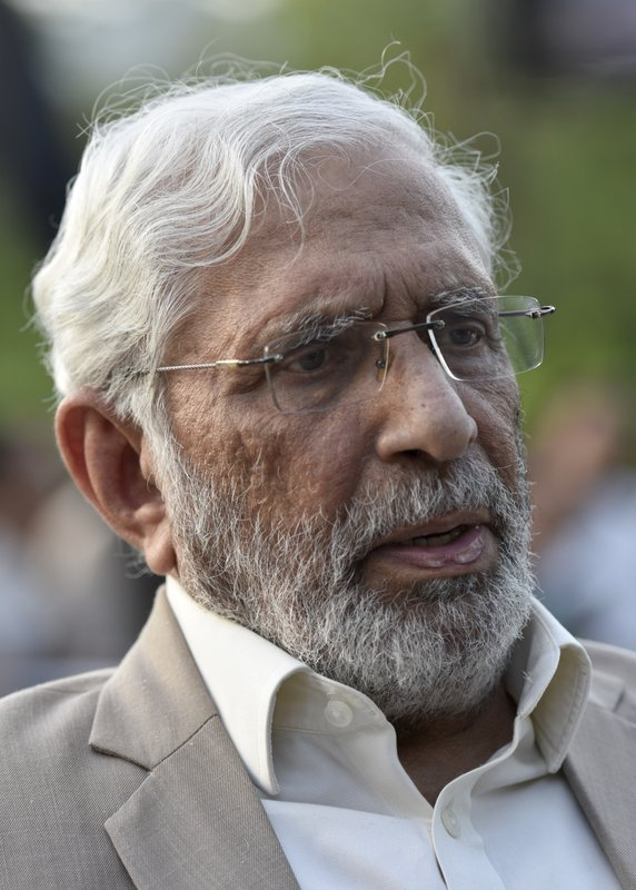 In this July 5, 2018 photo, Mohammad Ziauddin of the Pakistan Press Foundation, a free press advocacy group, speaks to The Associated Press, in Islamabad, Pakistan. (AP Photo/B.K. Bangash)