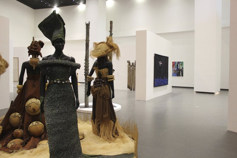 In this photo taken Thursday, Dec. 20, 2018, The Museum of Black Civilizations is seen during the inauguration in Dakar, Senegal. (AP Photo/Amelia Nierenberg)