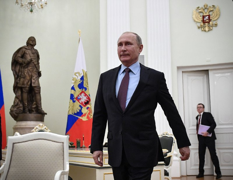Russian President Vladimir Putin arrives to attend the talks with his Belarusian counterpart Alexander Lukashenko, in the Kremlin in Moscow, Russia, Tuesday, Dec. (Alexander Nemenov/Pool Photo via AP)