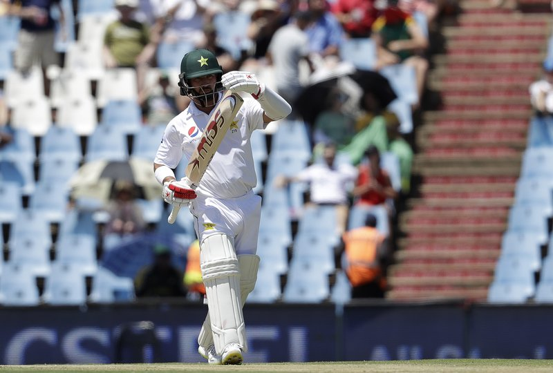 Pakistan's batsman Yasir Shah signals a review after South Africa's bowler Kagiso Rabada's LBW appeal on day one of the cricket test match between South Africa and Pakistan at Centurion Park in Pretoria, South Africa, Wednesday, Dec. (AP Photo/Themba Hadebe)