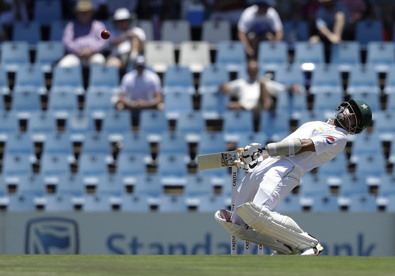 Pakistan's batsman Azhar Ali avoids a bouncer from South Africa's bowler Duanne Olivier on the day one of the cricket test match between South Africa and Pakistan at Centurion Park in Pretoria, South Africa, Wednesday, Dec. (AP Photo/Themba Hadebe)