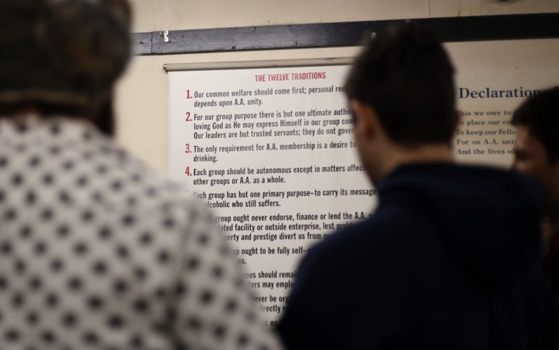 In this Dec. 8, 2018, photo, young men gather to talk after a 12-step meeting for Internet & Tech Addiction Anonymous in Bellevue, Wash. (AP Photo/Martha Irvine)