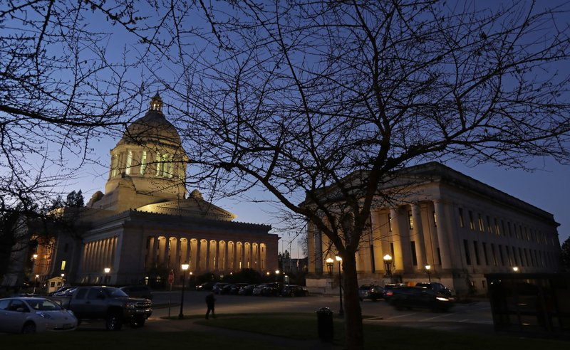 This Dec. 4, 2018, photo, shows the Legislative, left, and Insurance buildings at dusk at the Capitol in Olympia, Wash. (AP Photo/Ted S. Warren)