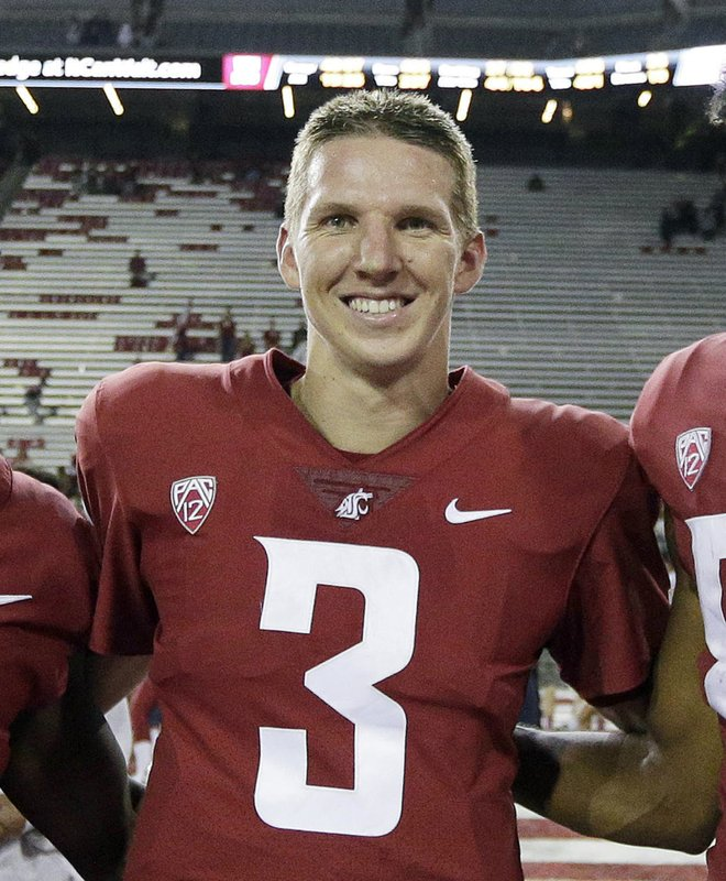 FILE - In this Sept. 9, 2017, file photo, Washington State quarterback Tyler Hilinski poses for a photo after an NCAA college football game against Boise State in Pullman, Wash. (AP Photo/Young Kwak, File)