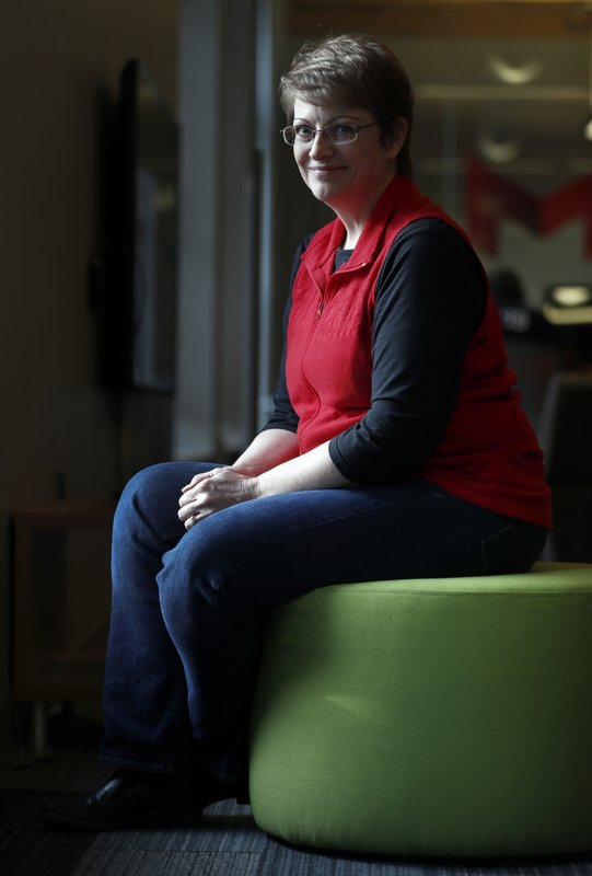 In this Wednesday, Dec. 19, 2018 photo, Kathy Barnes poses for a photo in St. Louis. Barnes, who helps small homebuilders and general contractors manage their projects, says her clients are worried that the bull market that gave customers the confidence to do major work on their homes is at an end. (AP Photo/Jeff Roberson)
