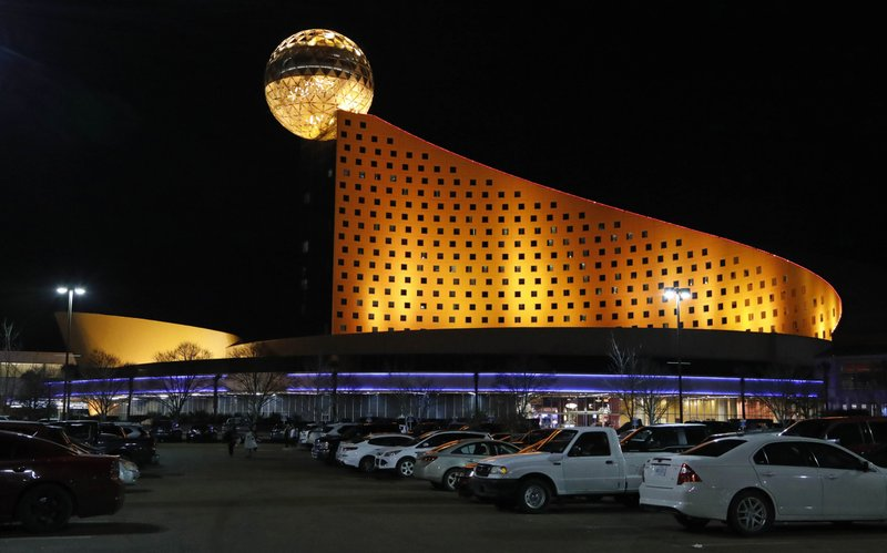 In this Dec. 18, 2018 photo, the Golden Moon Hotel and Casino, part of the Pearl River Resort is lit in Philadelphia, Miss. (AP Photo/Rogelio V. Solis)