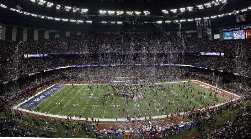 FILE - In this Feb. 3, 2013, file photo, streamers and confetti fall after the Baltimore Ravens won the NFL Super Bowl XLVII football game 34-31 over the San Francisco 49ers in New Orleans. (AP Photo/Charlie Riedel, File)