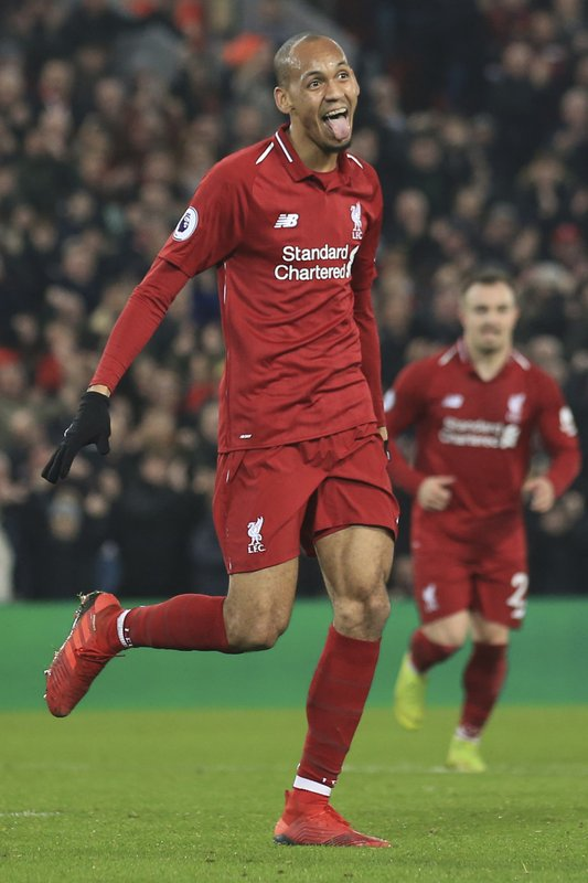Liverpool's Fabinho celebrates after scoring his side's fourth goal during the English Premier League soccer match between Liverpool and Newcastle at Anfield Stadium, Liverpool, England, Wednesday, Dec. (AP Photo/Jon Super)