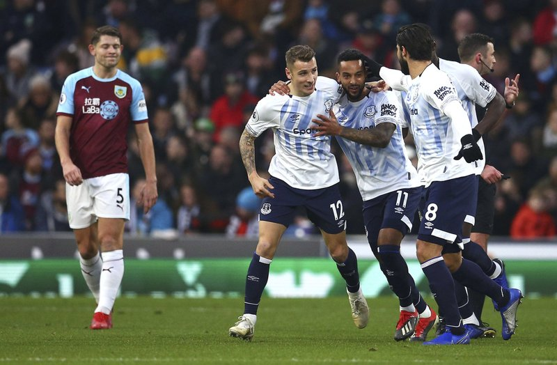 Everton's Lucas Digne, fourth right, celebrates scoring his side's second goal of the game with teammates during the English Premier League soccer match between Burnley and Everton at Turf Moor, in Burnley, England, Wednesday, Dec. (Dave Thompson/ PA via AP)